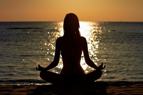 Woman in yoga lotus  meditation at seaside